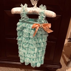 Infant lace romper from a boutique. Worn once